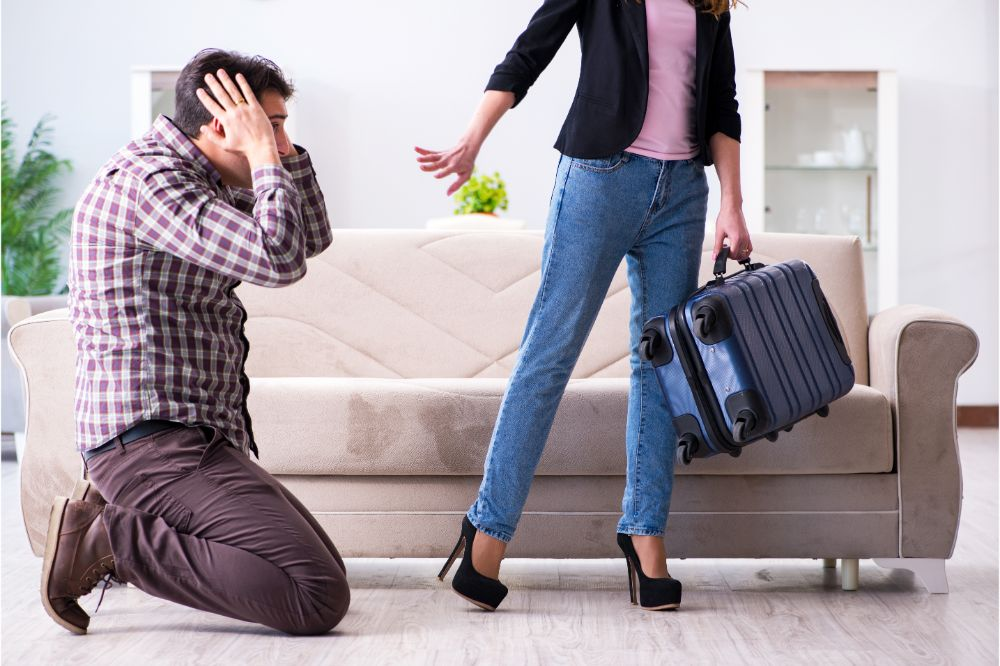 woman with suitcase leaving her husband