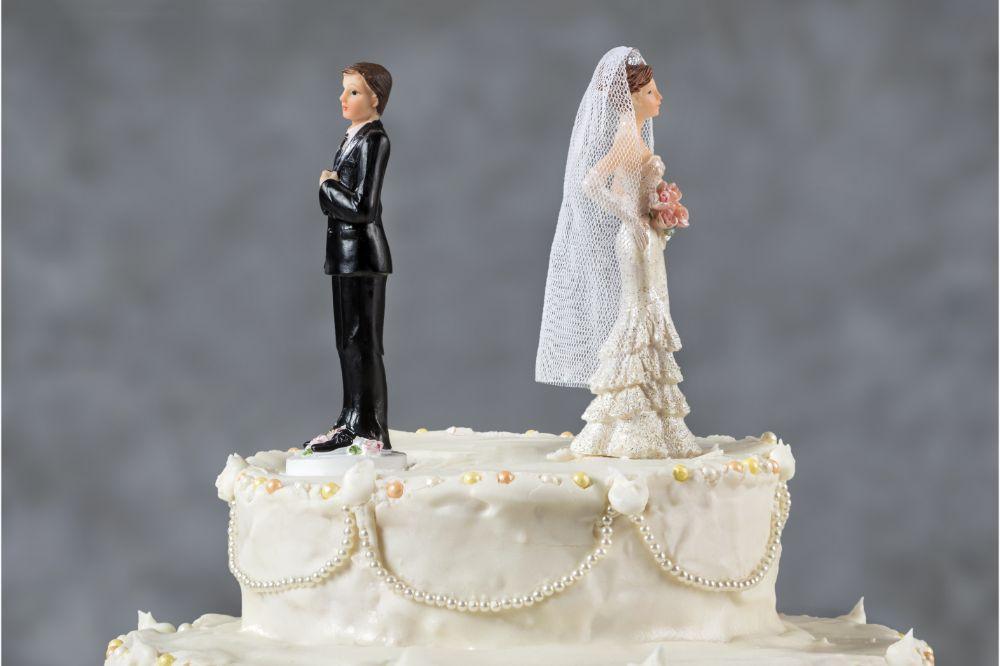 figurine couple in a cake