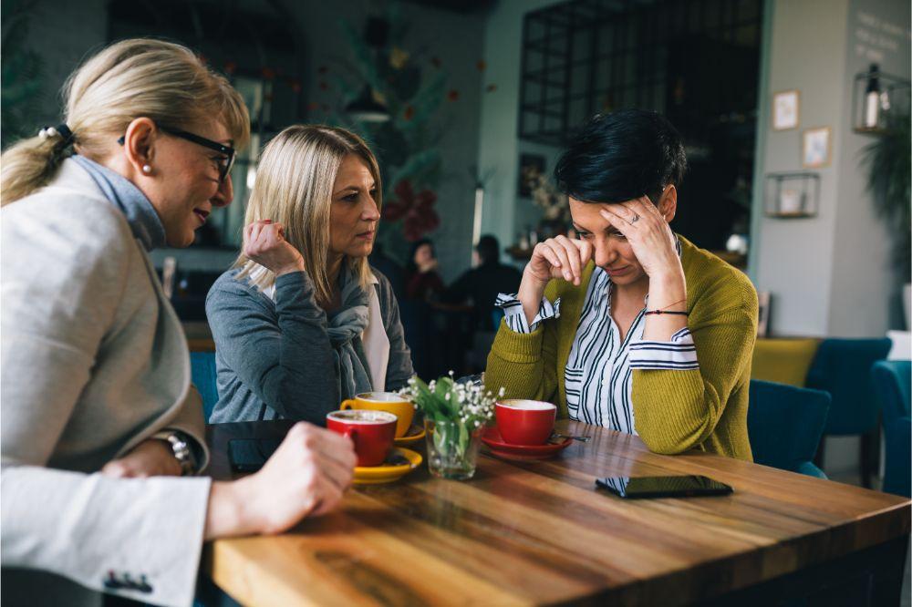 women consoling their friend