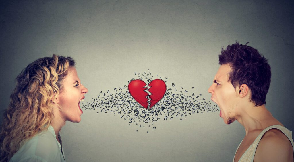 man woman screaming at each other alphabet broken heart in-between