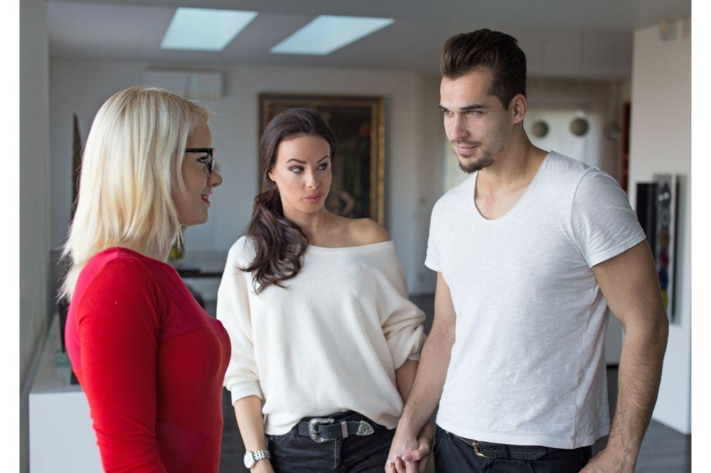 Girlfriend shocked on disloyal boyfriend flirting with woman in red dress